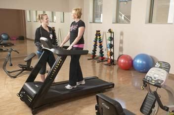 Fitness coordinator works with patients during and after treatment.